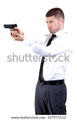 young man with a pistol - stock photo