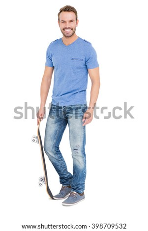Young man with a skateboard on white background - stock photo