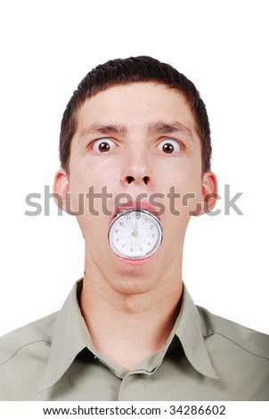 Young man with a watch in his mouth - stock photo