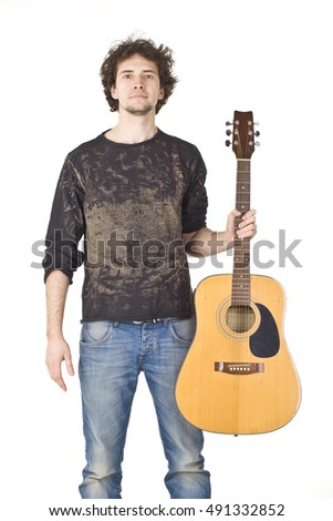 Young man with acustic guitar.