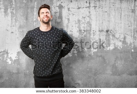 young man with back ache - stock photo