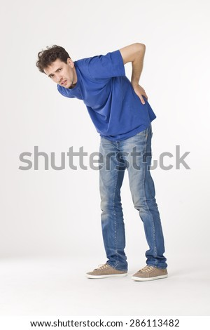 Young man with back pain. - stock photo