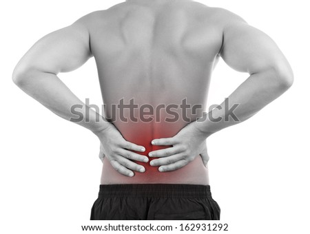 Young man with back pain, isolated on white - stock photo