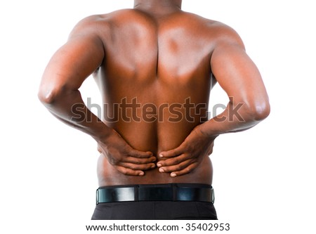 Young man with back pain isolated on white - stock photo