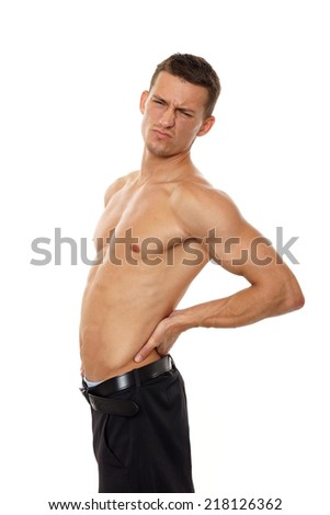 Young man with back pain on isolated white background - stock photo