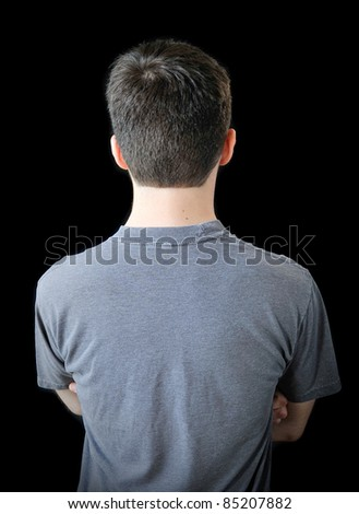 Young man with back turned and arms crossed. - stock photo