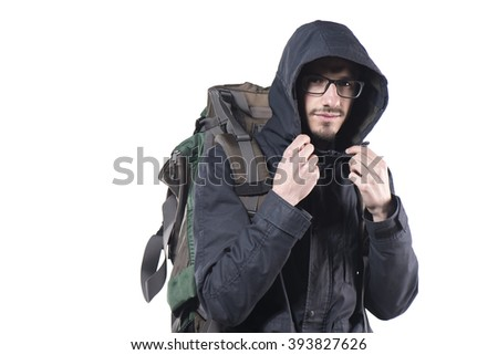 Young man with backpack walking isolated on white background