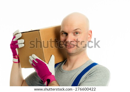 young man with bald head and cardboard in front of white background - stock photo