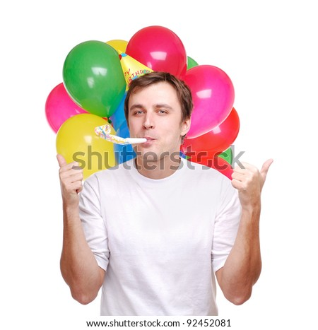 Young man with balloons and party decorations over the white background - stock photo