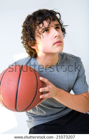 Young man with basketball. He's looking up. - stock photo