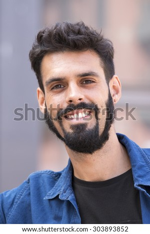 Young man with beard - stock photo