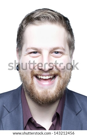 Young man with beard showing emotion up close - stock photo