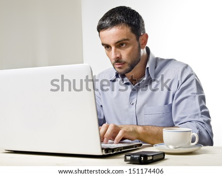 Young Man with Beard Working on Laptop isolated on a White Background - stock photo