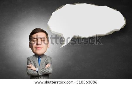Young man with big head thinking about something with eyes closed - stock photo