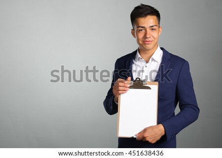 young man with blank clipboard - stock photo