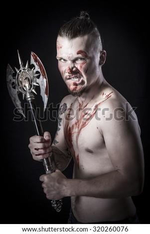 young man with blood and ax