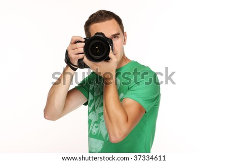 Young man with camera. - stock photo