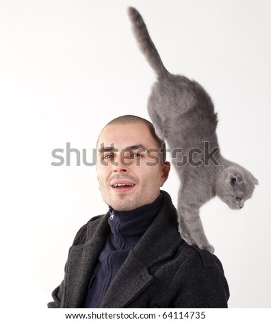 Young man with cat - stock photo