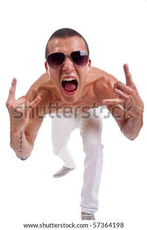 Young man with characteristic heavy metal hand gesture - stock photo