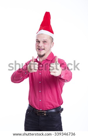 young man with Christmas hat  - stock photo