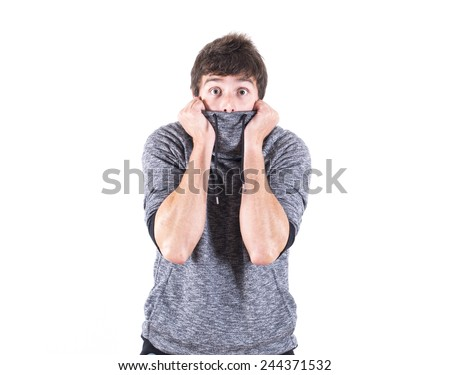 young man with cold covering his mouth with sweater