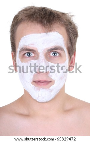 young man with cosmetic mask on his face over white