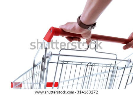 Young man with empty shopping cart isolated on white - stock photo