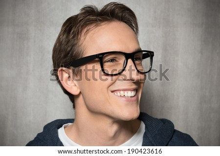 Young Man With Eyeglasses Smiling - stock photo