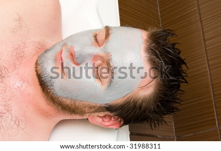 young man with facial mask - stock photo