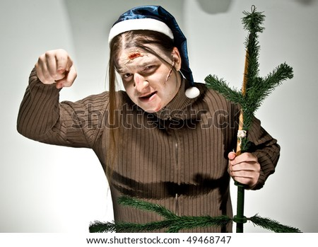 Young man with fake cicatrice and bruise on his face - stock photo