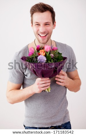 young man with flowers - stock photo