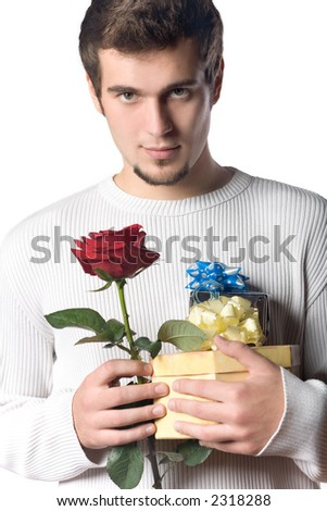 Young man with gifts and rose - stock photo