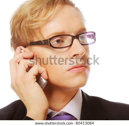 Young man with glasses use mobile isolated on white background