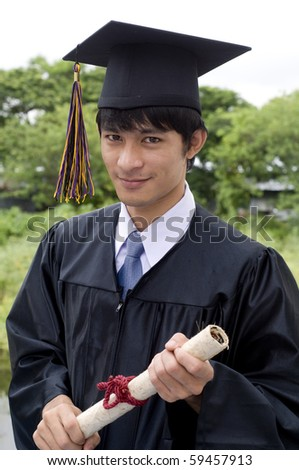Young man with graduation cap and gown and diploma
