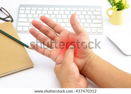 Young man with hand pain with red alert accent - stock photo