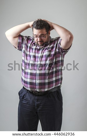 Young man with hands on top of his head, in arrested position - stock photo