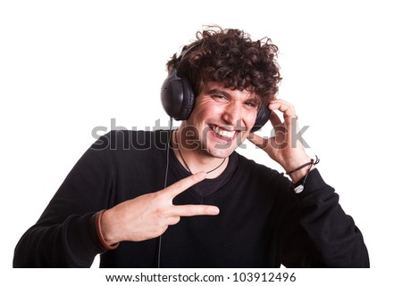 Young Man with Headphones Listening Music - stock photo
