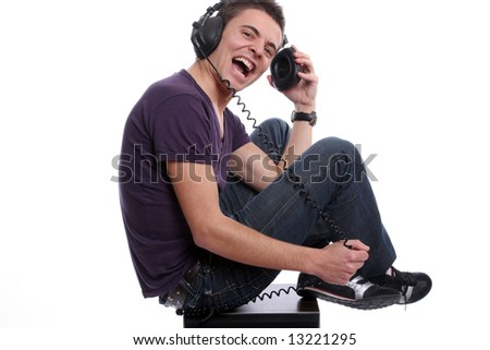 Young man with headphones, seating in a speaker, isolated in white background