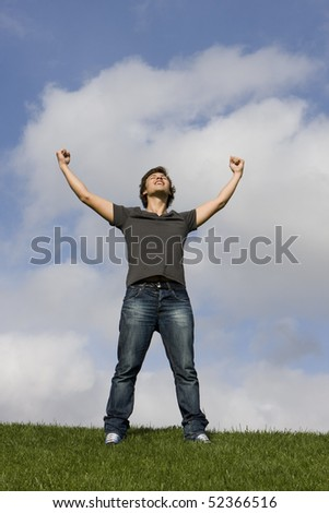 Young man with his arms outstretched - stock photo