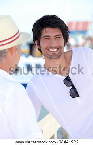 Young man with his father on holiday - stock photo