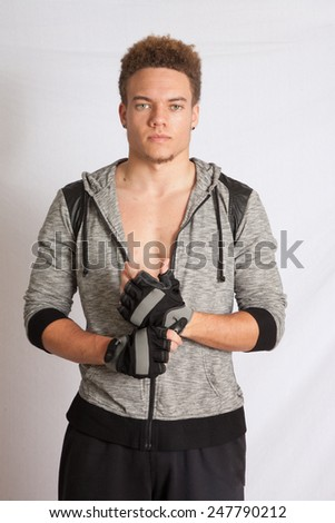 Young man with his jacket open, looking thoughtfully at the camera  - stock photo