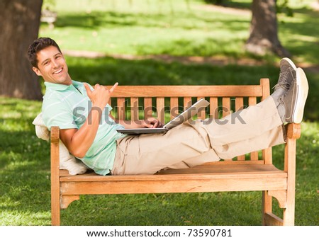 Young man with his laptop - stock photo