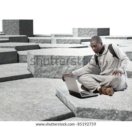 young man with laptop on 3d abstract background - stock photo