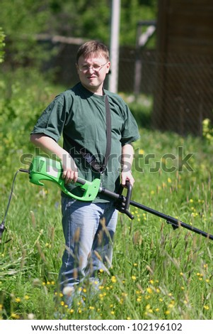 Young man with lawnmower