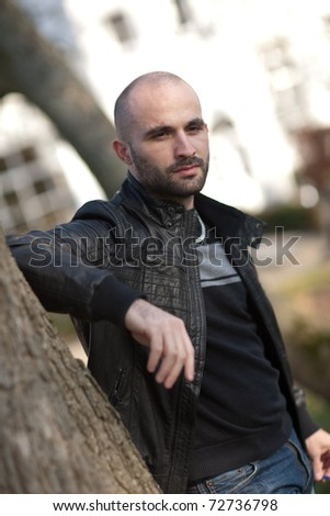 Young man with leather jacket - stock photo