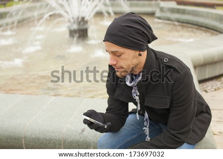 Young Man With Mobile Phone Outdoor - stock photo