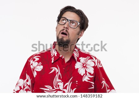 Young man with mouth open contemplating  - stock photo