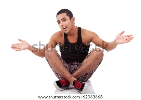 young man with open arms, sitting on floor, isolated on white, studio shot - stock photo