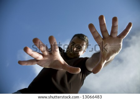young man with open hands - focus on the hands - stock photo