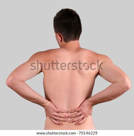 young  man with pain in a back isolated on white